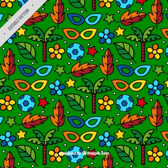 Green pattern with hand drawn masks and natural elements