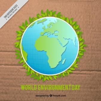Green world over cardboard background
