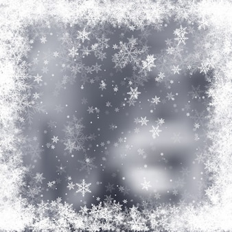 Grey blurred background with snowflakes frame