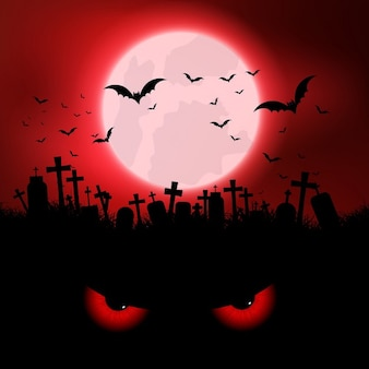Halloween background with evil eyes and graveyard
