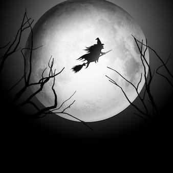 Halloween background with silhouette of a witch flying in the night sky