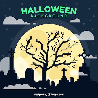Halloween background with tree in the cemetery