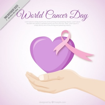 Hand background with a world cancer day heart