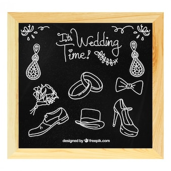 Hand drawn accessories of wedding in blackboard
