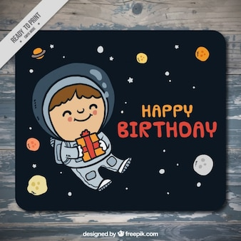 Hand drawn astronaut in the space birthday card