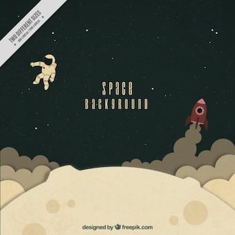 月面の背景にロケットと手描きの宇宙飛行士