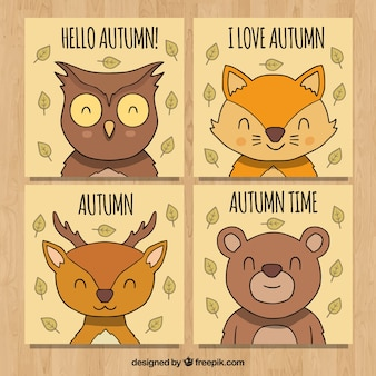 Hand drawn autumn cards with smiley animals