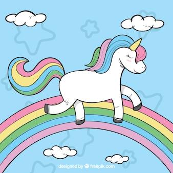 Hand drawn background of unicorn with rainbow