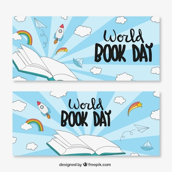 Hand-drawn banners with clouds and rockets for world book day