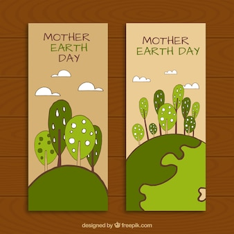 Hand-drawn banners with decorative trees for mother earth day