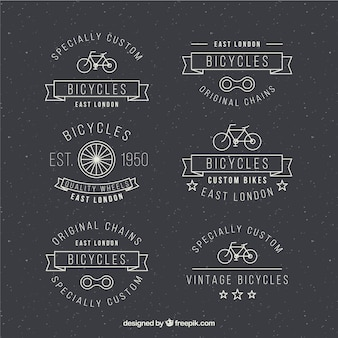 Hand drawn bicycles badges in retro design
