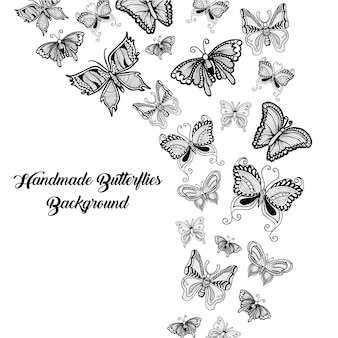 Hand drawn black and white butterflies background