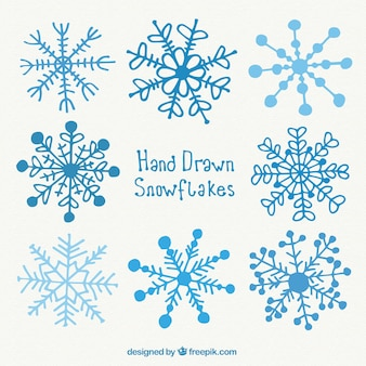Hand drawn blue snowflakes