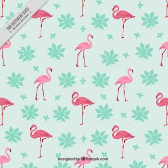 Hand drawn flamingos background with leaves