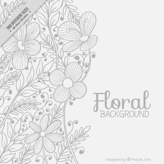 手は葉と花の背景を描か
