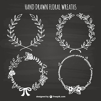 Hand drawn floral wreaths on blackboard