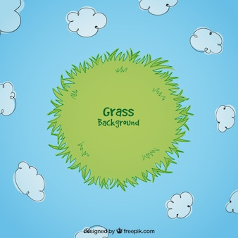 Hand-drawn grass background with clouds