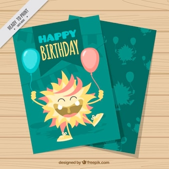 Hand drawn happy monster with balloons birthday card