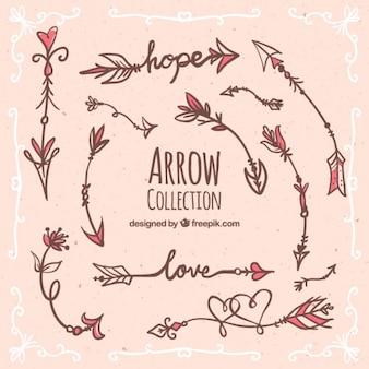 Hand drawn romantic arrows set