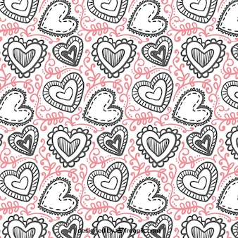 Hand-drawn valentines pattern of hearts with different designs
