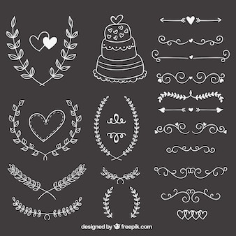 Hand drawn wedding ornaments on blackboard