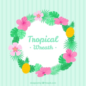 Hand drawn wreath of palm leaves with tropical flowers
