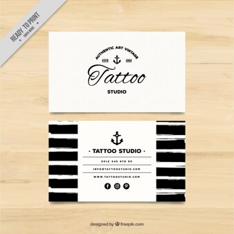 Hand painted business card for a tattoo studio