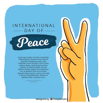 Hand with peace symbol on blue background
