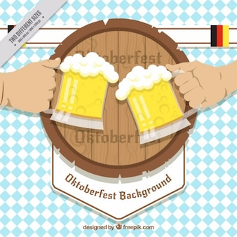 Hands holding mugs of beers with barrel background