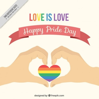 Hands with a colorful heart pride day background
