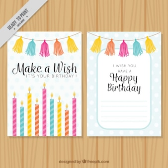 Happy birthday card with colorful candles and garlands
