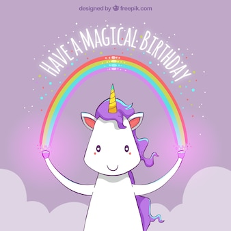 Happy birthday unicorn background with a rainbow