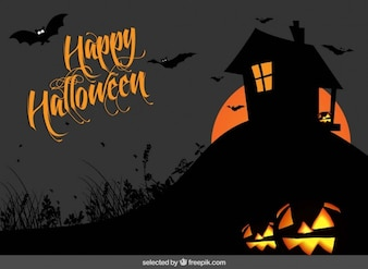 Happy halloween background with a house silhouette