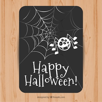 Happy halloween card with a spider