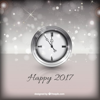 Happy new year background with a silver clock
