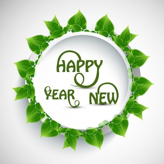 Happy new year text with green leaves