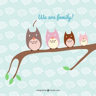 Happy owl family in a branch