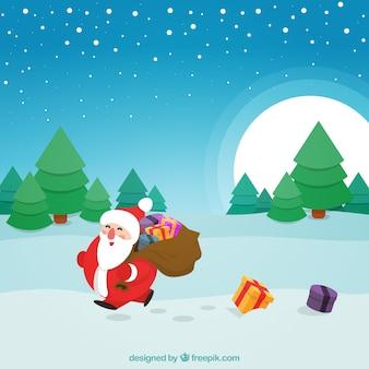 Happy santa claus walking in the snow