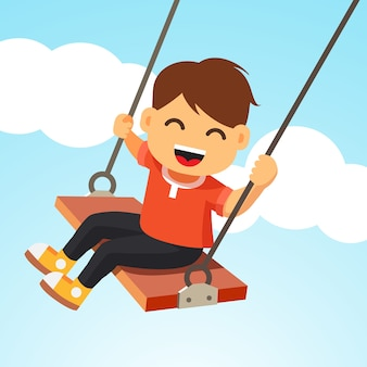 Happy smiling boy kid swinging on a swing