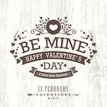 Happy valentine on a wooden background
