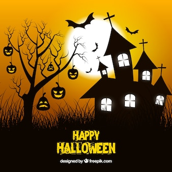 Haunted house background and tree with pumpkins