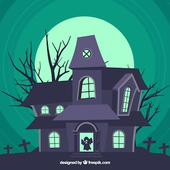 Haunted house with tombstones