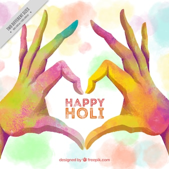 Holi festival background with hands making a heart