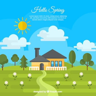 House background on a green meadow with flowers