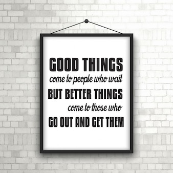 Inspirational quote in picture frame hanging on a brick wall