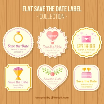Labels about weddings on wood background