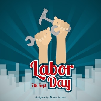 Labor day background with hands holding tools