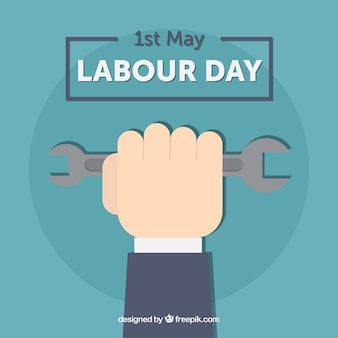 Labour day background of hand with tool