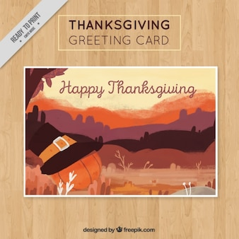 Landscape card with thanksgiving pumpkin and hat