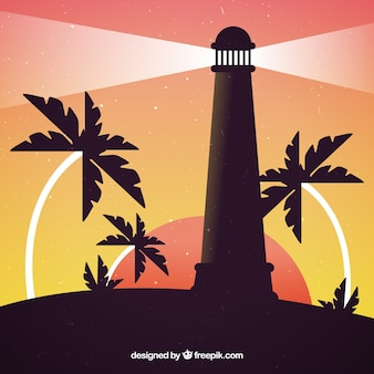 Lighthouse at sunset with palm trees background